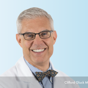Dr. Clifford Gluck a boston hair transplant surgeon in medical lab coat.
